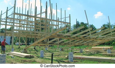 Building and Raising a Barn - Carpenters working on building...