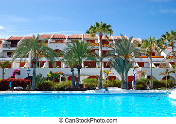 Building and recreation area of luxury hotel with swimming pool, Tenerife island, Spain