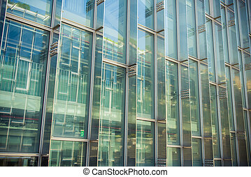 Building and reflect building on glass wall