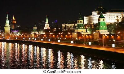 Building and towers of Kremlin, river and cars in Moscow city