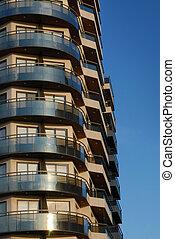 Building balconies on a blue sky
