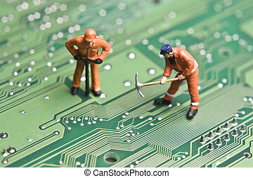 Building better technology - Worker figurines posed to look...