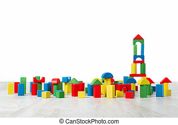 Building blocks toy over floor in white empty interior. Childrenroom design.