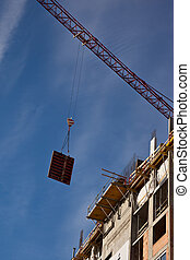 Building construction - Crane manipulation at the high ...