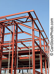 Vertical view of a red steel building construction framework.