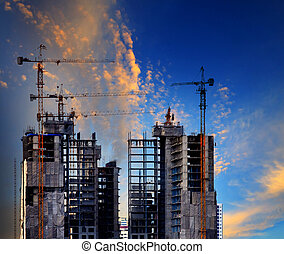 building construction site against beautiful blue sky use for co