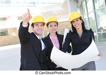 Building Construction Team - A handsome business man and...