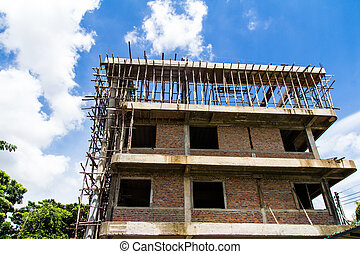 Building construction with blue sky background