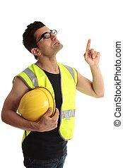 Building construction worker lookin up pointing