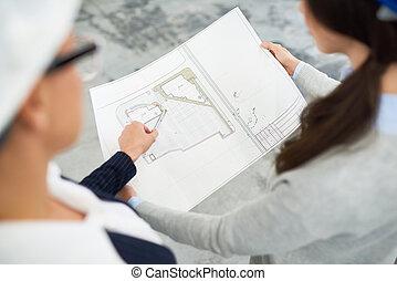 Building contractors working on housing plan