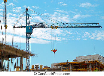 Building crane and the building under construction.
