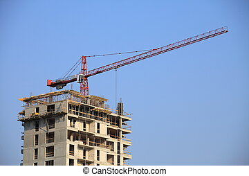 building crane blue sky - Construction works on a highrise...