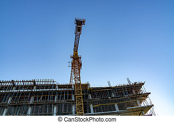 Building crane on the sky background. Constructions.