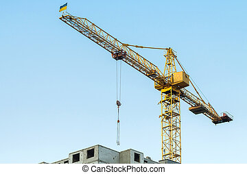 Building crane with flag.