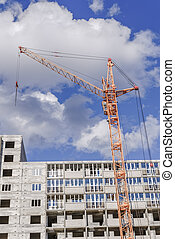 Building cranes and building house.