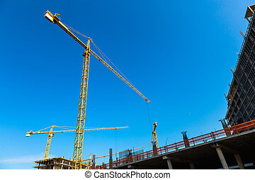 Building cranes on construction