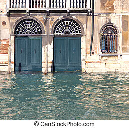 Building doors flooded by high water in Venice