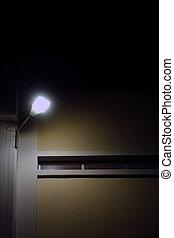 building exterior illuminated by flood light at night