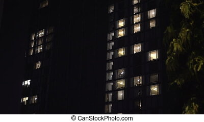 Building exterior in the evening with interior lights