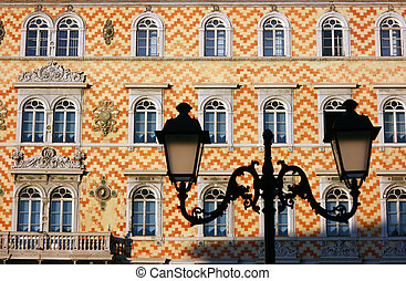 Building facade and lamp silhouette