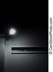 building facade illuminated by street light at night