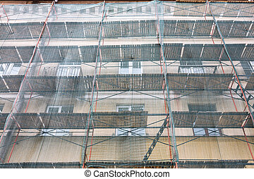 building facade renovation with green protective net