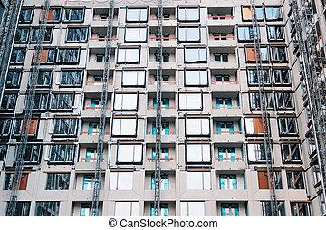 building facade under construction, real estate development -