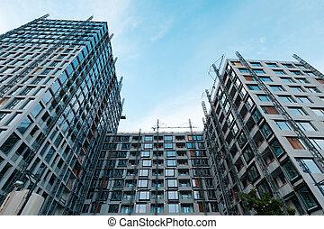 building facade under construction, real estate development