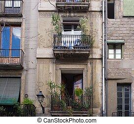 Building facade with beautiful balconies