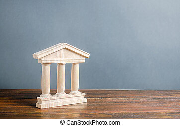 Building figurine with pillars in antique style. Concept of city administration, bank, university, court or library. Architectural monument in the old part of the town. Banking, education, government.