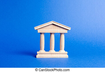 Building figurine with pillars in antique style. Concept of city administration, bank, university, court or library. Architectural monument in the old part of the city. Banking, education, government.