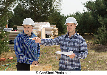 Building foreman giving instructions