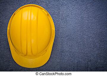 Building helmet on black background construction concept