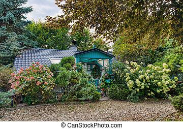 building house in summer garden