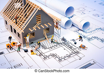 building house on blueprints with worker - construction...