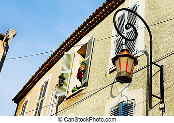 Building in Antibes - Building with shutters on windows and...