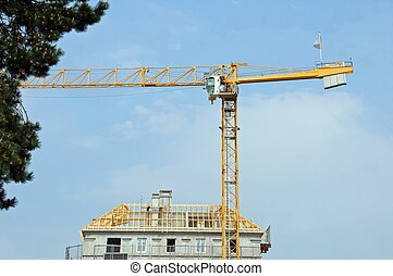 building in construction and crane