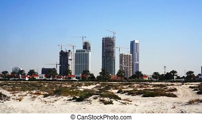 Building in Dubai. Skyscrapers and high-rise buildings. -...