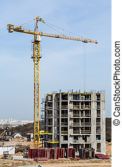 Building multi-storey houses and tall cranes.