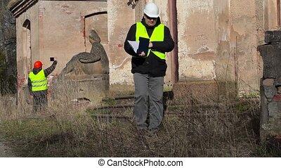 Building inspector checking documentation