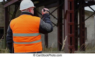 Building inspector filmed with camcorder in factory