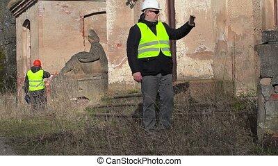 Building inspector filming