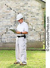 Building Inspector Foundation Damage - Inspector inspecting...