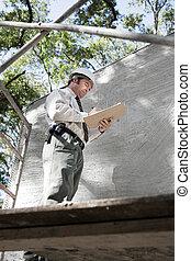 Building Inspector on Scaffolding