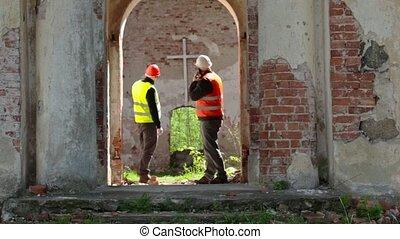 Building inspector talking on smart