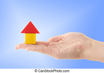 Building Insurance - A human hand holding a stylized house...