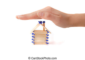 Building Insurance - A human hand protecting a stylized...
