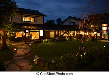 Building Japanese Style in Garden at Night Time