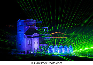 Illiuminated building with laser beams and different colors.