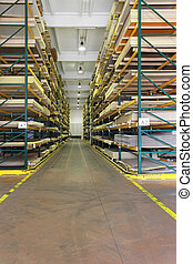 Building materials warehouse - Corridor with shelves in...